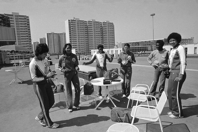 Peruvian volley ball girls dancing to Latin rhythms from a tape recorder at their table at the Plaza of the Olympic Village in Moscow, July 9, 1980