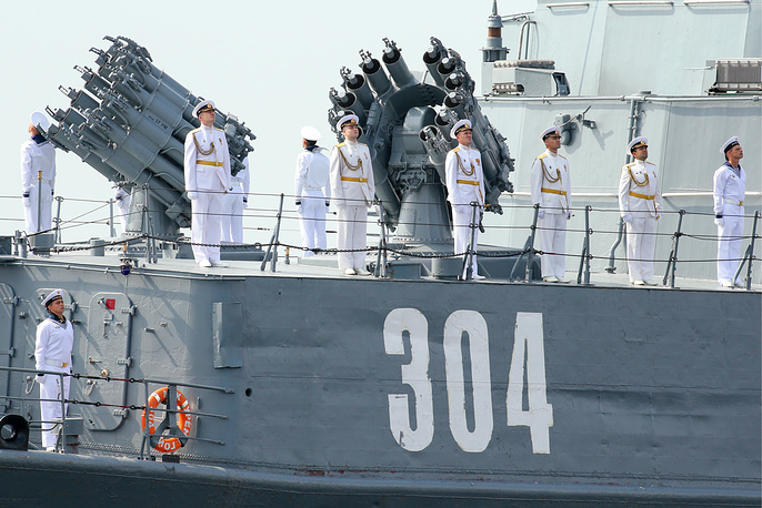 Crew members aboard the Urengoy small anti-submarine ship taking part in the dress rehearsal of a naval parade marking the Day of the Russian Navy, on the Neva River