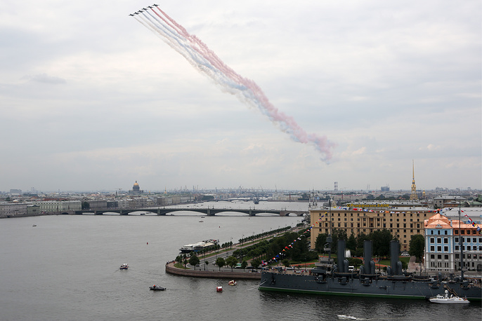 Su-25 jets leave a trail in the Russian national colours as they participate in the dress rehearsal of a military parade marking the Day of the Russian Navy in Saint Petersburg