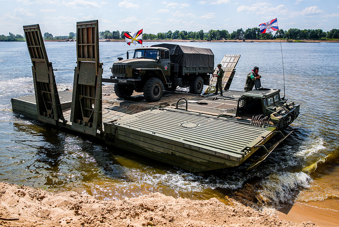 Ural military truck on a ferry bridge machine