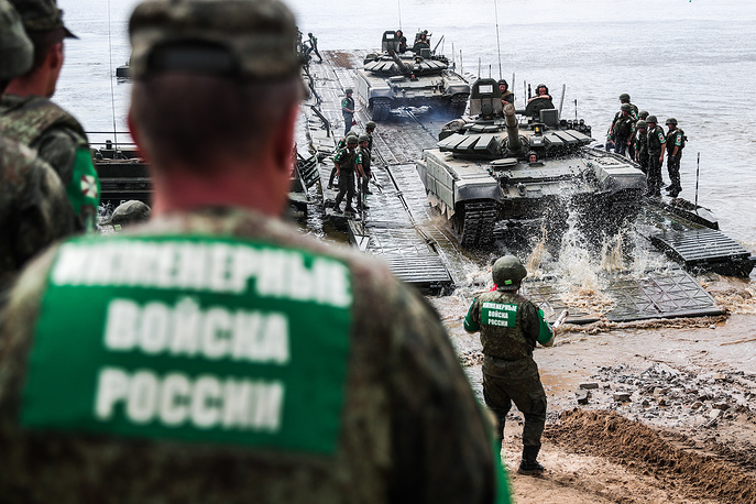 Russian soldiers compete in the Open Water contest between pontoon bridge units on the Oka River