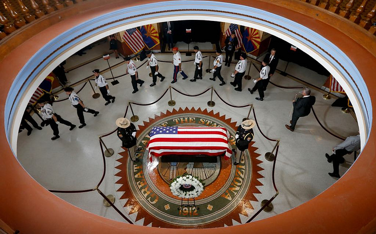 Arizona Cardinals President, Michael Bidwill pays his respects at the casket of Sen. John McCain during a memorial service at the Arizona Capitol in Phoenix, August 29. John McCain died August 25 at the age of 81 after a long battle with Glioblastoma, a form of brain cancer