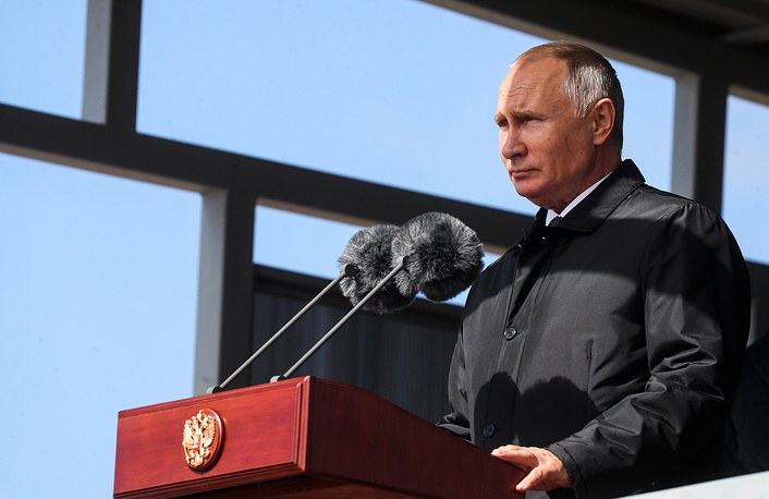 Russia's President Vladimir Putin attends a parade of army hardware and aviation involved in the main stage of the Vostok 2018 military exercises