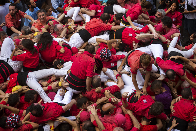 "The tradition of building human towers or ""castells"" dates back to the 18th century and takes place during festivals in Catalonia, where ""colles"" or teams compete to build the tallest and most complicated towers"