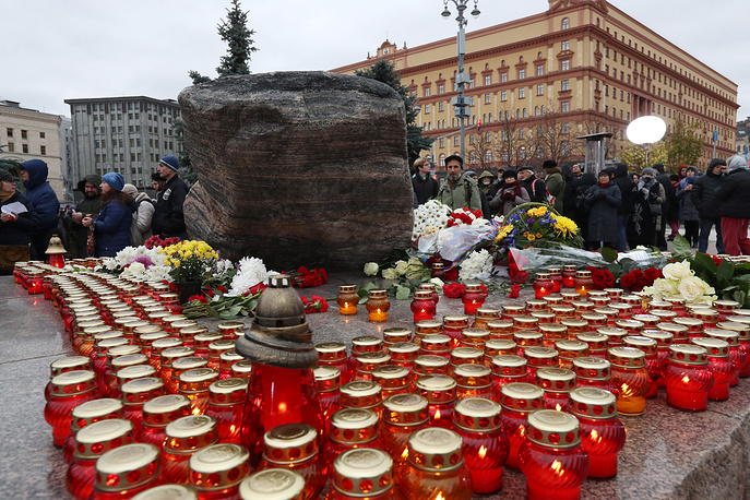 An event commemorating the victims of political repressions by the Solovetsky Stone monument in Lubyanka Square in Moscow