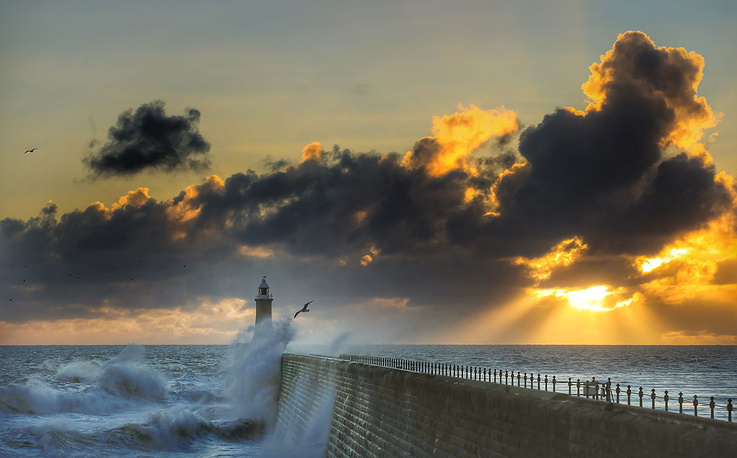 Rough seas are buffeted against Tynemouth Pier, as the sun rises in Tynemouth, England, October 28