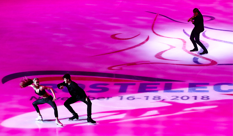 Hungarian violinist Edvin Marton and gold medalists in ice dancing Aleksandra Stepanova and Ivan Bukin of Russia