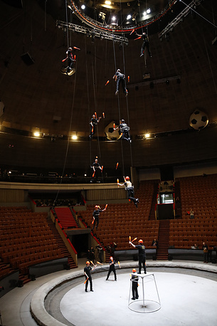 Artists of the Great Moscow State Circus perform their Guinness world record-breaking trick involving twelve club jugglers suspended at different heights