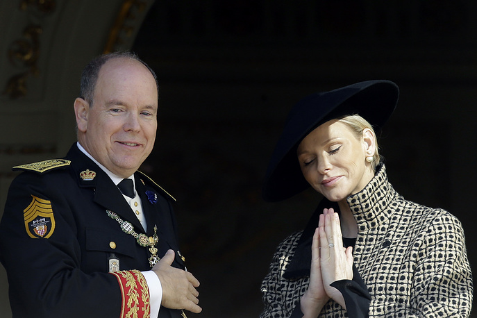 Prince Albert II of Monaco and his wife Princess Charlene thank the crowd as they attend from the Monaco Palace to the ceremonies marking the National Day in Monaco, November 19