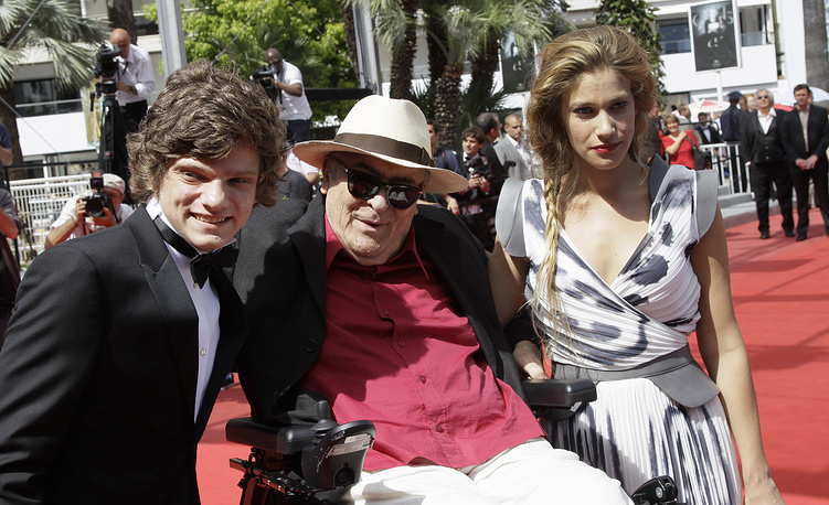 Jacopo Olmo Antinori, director Bernardo Bertolucci and actress Tea Falco arrive for the screening of Me and You at the 65th international film festival, in Cannes, southern France, 2012