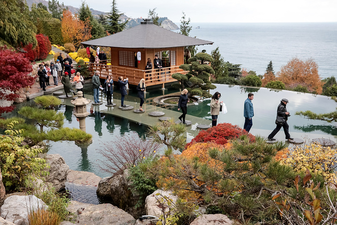 People visiting the Japanese garden opened in Aivazovskoye Park in the village of Partenit in southern Crimea, November 24