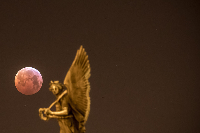 A view of the so-called 'super blood wolf moon' is seen over the city center in Prague
