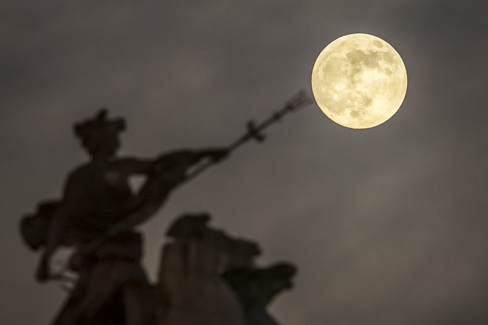 A super moon is seen above the 'Maritime Prowess' by Albert Hemstock Hodge on the Guild Hall, England