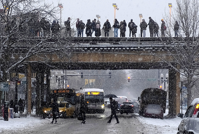 Commuters wait for a train in Chicago