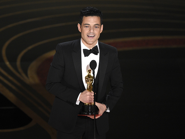 "Rami Malek accepts the award for best performance by an actor in a leading role for ""Bohemian Rhapsody"""