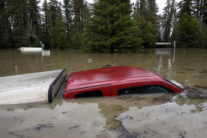 A river in Northern California's wine country reached flood stage and forecasters expect it to rise even more as a winter storm lashes the region