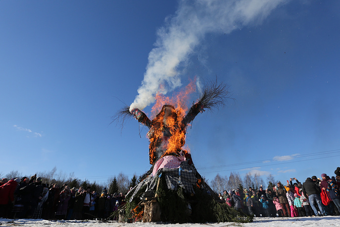 People watch the burning effigy of the Lady Maslenitsa during the celebrations in Belarus