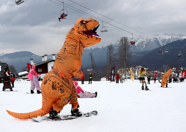 Snowboarders in costumes take part in the 4th BoogelWoogel Alpine Carnival at the Rosa Khutor Resort in Sochi, March 15
