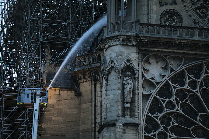 Firefighters operating on the Notre Dame cathedral after the fire in Paris