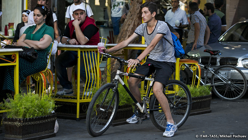 September 19. A young man riding a bicycle through city streets.
