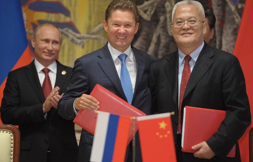 Russia's president Vladimir Putin, Gazprom management committee chairman Alexei Miller and China National Petroleum Corporation (CNPC) chairman Zhou Jiping ITAR-TASS/Alexei Druzhinin
