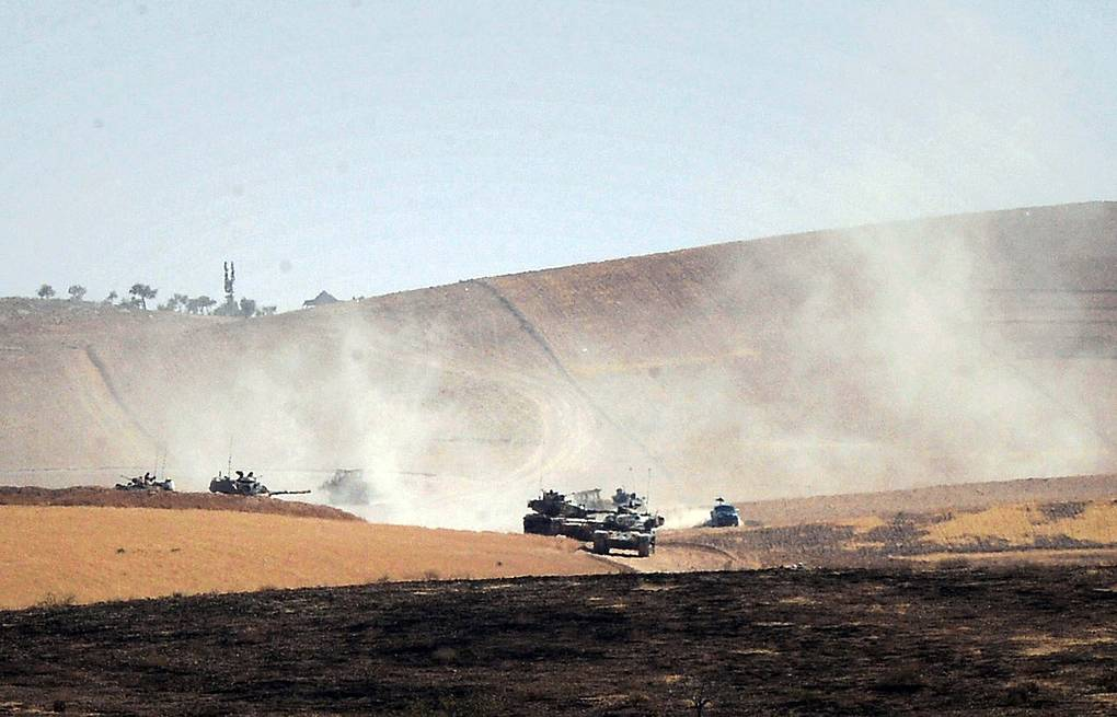 Turkish military moving inside Syria  Ismail Coskun, IHA via AP