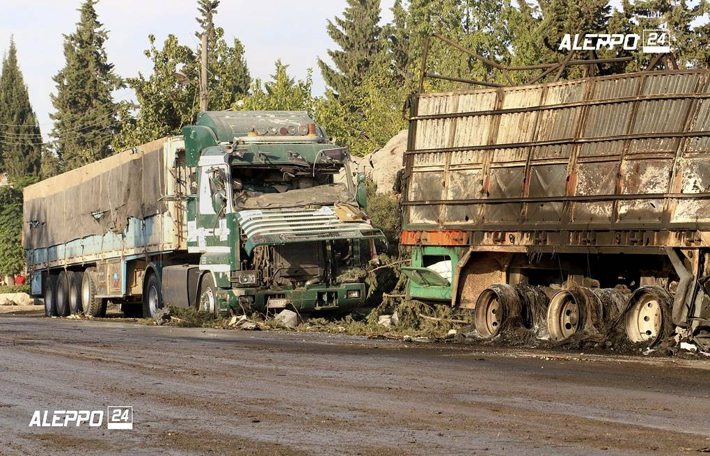 Damaged trucks carrying aid, in Aleppo, Syria Aleppo 24 news via AP