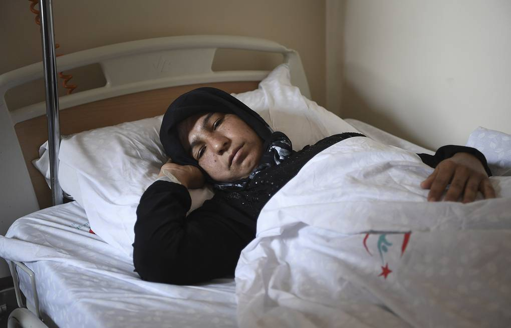 A Syrian woman rests in a hospital in Reyhanli, Turkey AP Photo