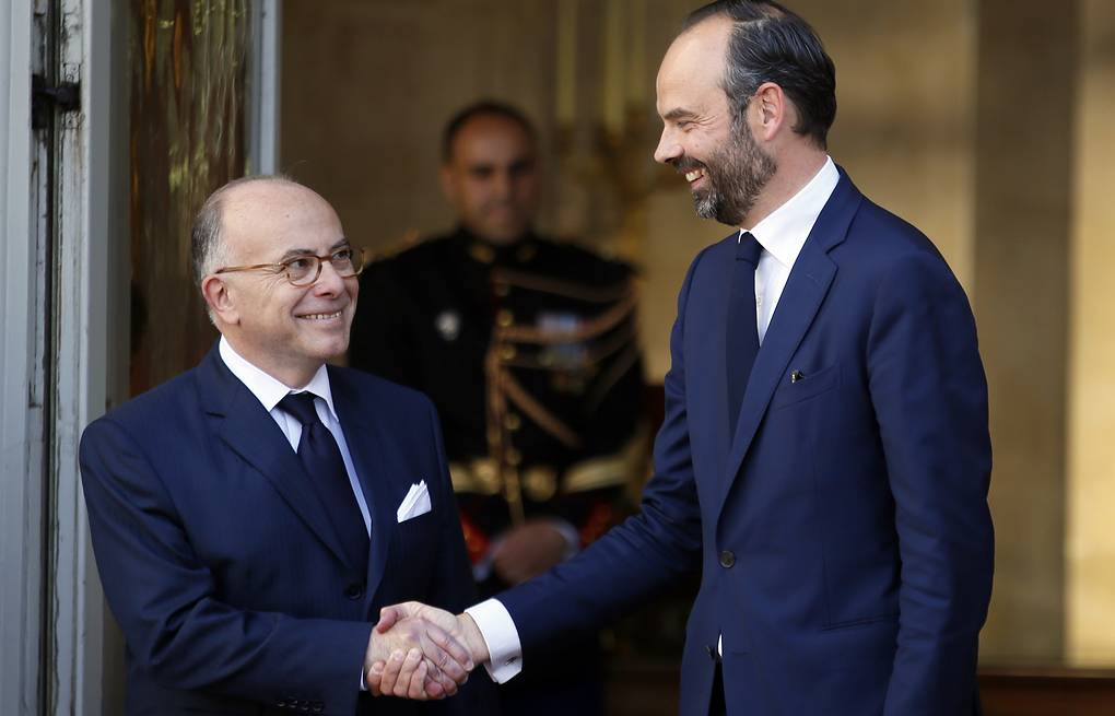 Outgoing French Prime Minister Bernard Cazeneuve and newly appointed French Prime Minister Edouard Philippe AP Photo/Francois Mori