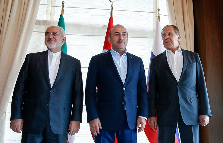 Iranian Foreign Minister Mohammad Javad Zarif, Turkish Foreign Minister Mevlut Cavusoglu and Russian Foreign Minister Sergei Lavrov meeting in Antalya Alexander Shcherbak / TASS