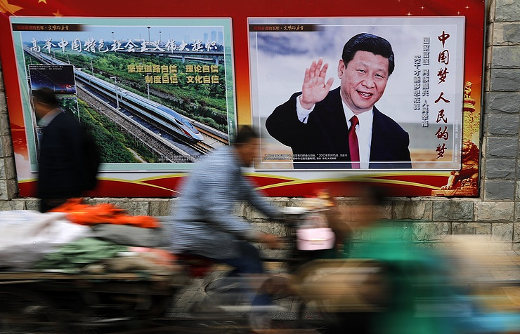 A poster with the image of China's leader Xi Jinping AP Photo/Andy Wong