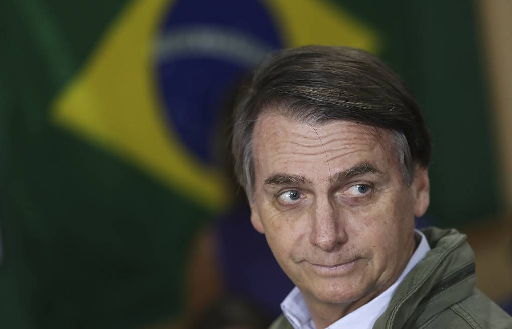 Jair Bolsonaro Ricardo Moraes/Pool Photo via AP