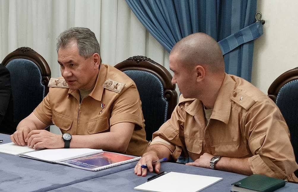 Russian Defense Minister Sergei Shoigu (left) Vadim Savitsky/Russian defense ministry's press service/TASS