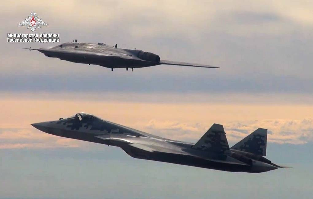 Russia's latest attack drone performs 1st joint flight with Su-57  fifth-generation plane - Military & Defense - TASS