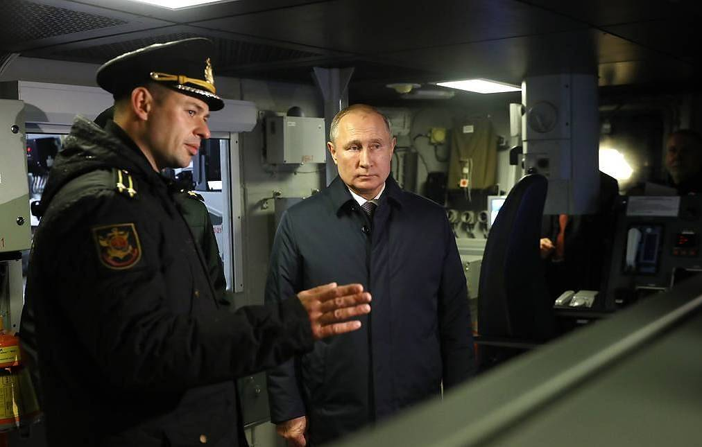Russian President Vladimir Putin is shown round the corvette Gremyashchiy Mikhail Tereshchenko/TASS