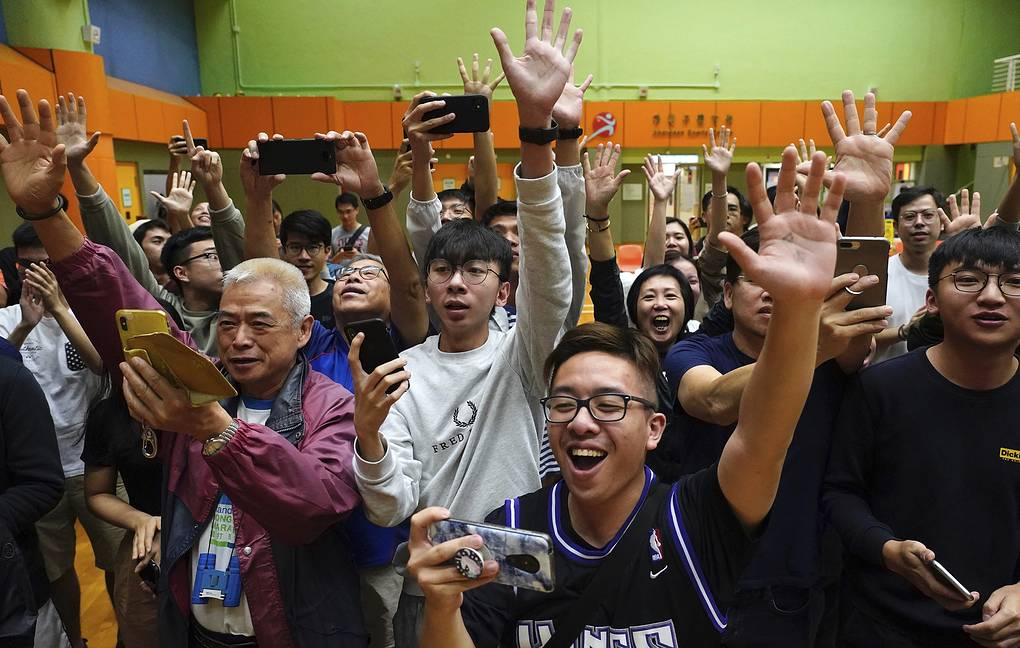 Supporters of pro-democracy candidate celebrating victory in district council elections in Hong Kong AP Photo/Vincent Yu