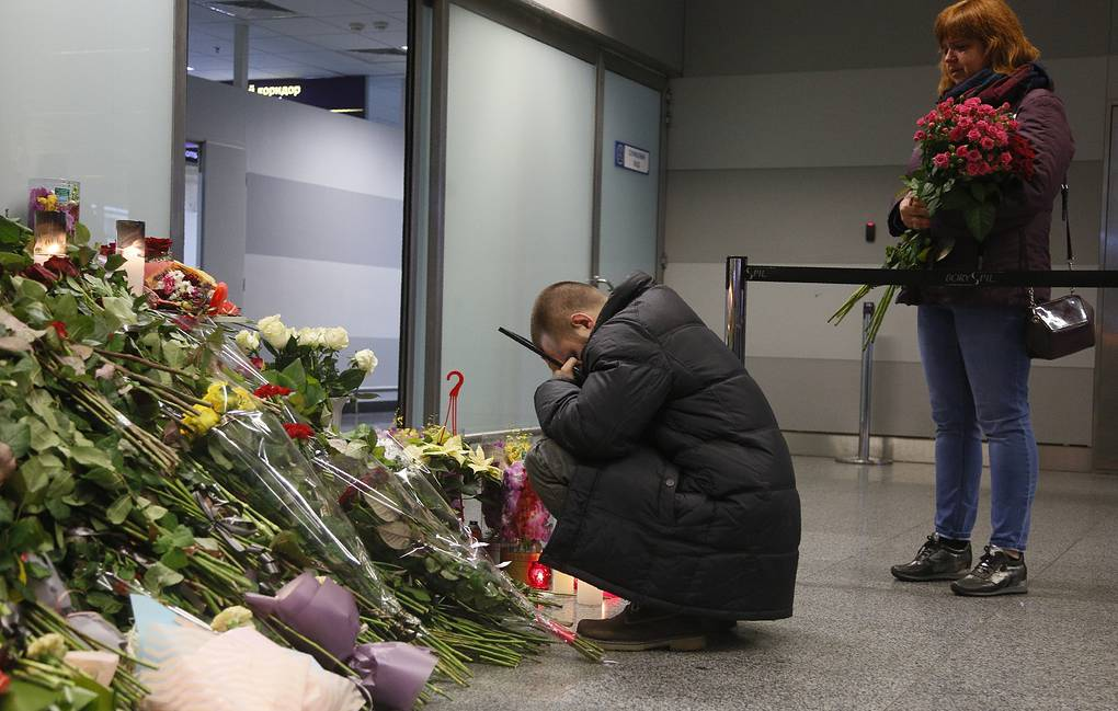 Flowers at a memorial of the flight crew members of the Ukrainian plane that crashed on the outskirts of Tehran, at Borispil international airport outside in Kiev AP Photo/Efrem Lukatsky