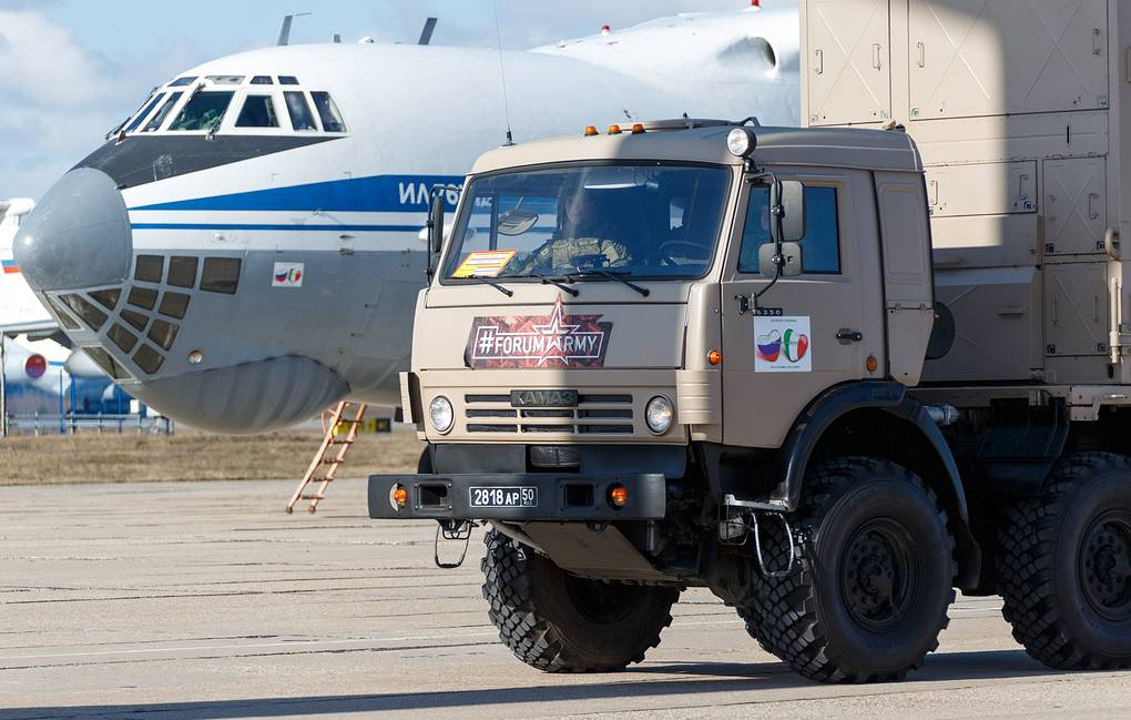 Loading medical equipment aboard planes of the Russian Aerospace Forces for sending it to the Italian regions worst hit by the COVID-19 coronavirus pandemic Russian Defense Ministry/TASS