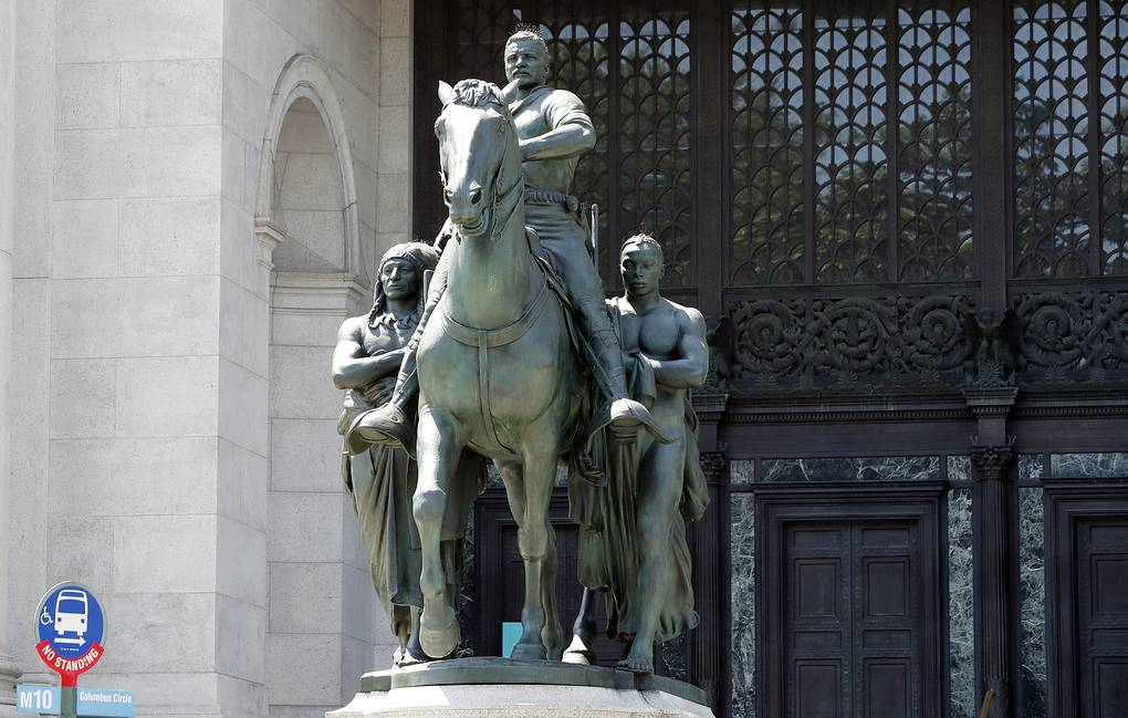 A statue of Theodore Roosevelt on horseback flanked by a Native American man and an African man in New York AP Photo/Kathy Willens