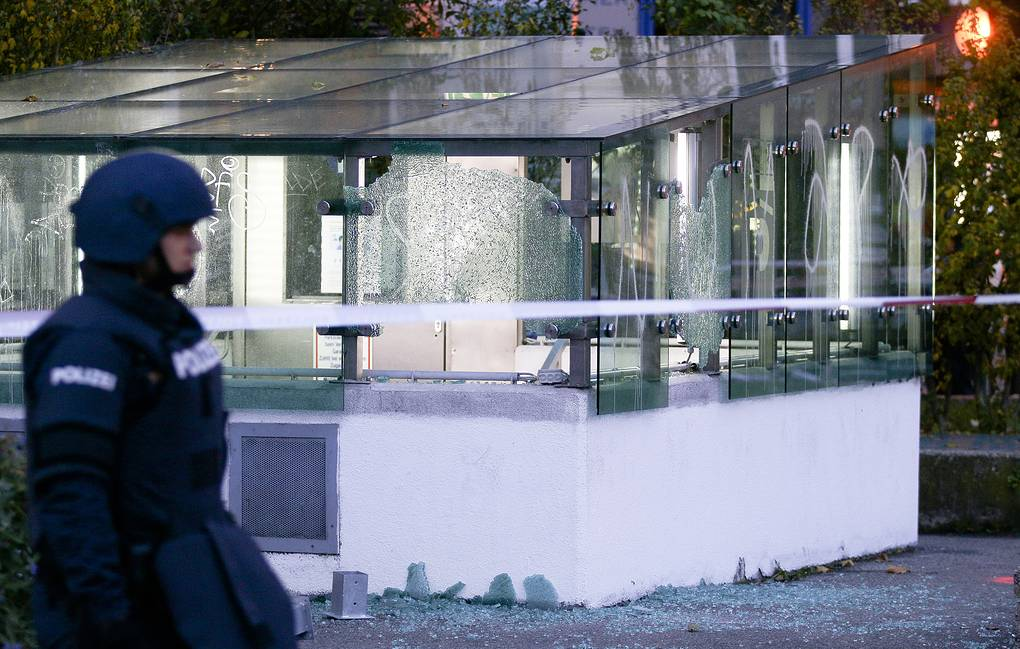 A police officer seen in front of an entrance of a car parking after a shooting in Vienna AP Photo/Ronald Zak