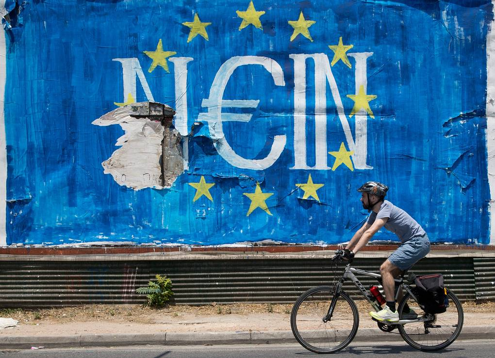 A man passes by a graffiti made by street artist N_Grams that read ''NO'' (Nein) in German but also sounds like ''YES, IN'' in Greek language, in Athens, Greece, 05 July 2015. Greek voters in the referendum are asked whether the country should accept reform proposals made by its creditors. EPA/KAY NIETFELD