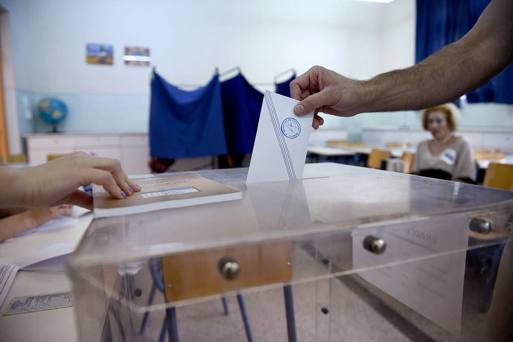 A man casts his vote at a polling station in the northern Greek port city of Thessaloniki, Sunday, July 5, 2015. Greeks began voting early Sunday in a closely-watched, closely-contested referendum, which the government pits as a choice over whether to defy the country's creditors and push for better repayment terms or essentially accept their terms, but which the opposition and many of the creditors paint as a choice between staying in the euro or leaving it. (AP Photo/Giannis Papanikos)