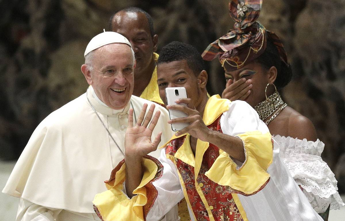 This week in photos: a selfie with the Pope, Putin's fish and a tank race