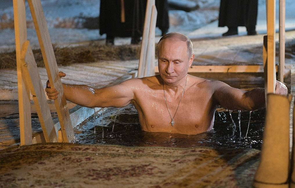 Putin takes plunge in icy waters to celebrate Orthodox Epiphany