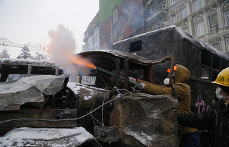 Protesters use fireworks during clashes with police in central Kiev, Ukraine