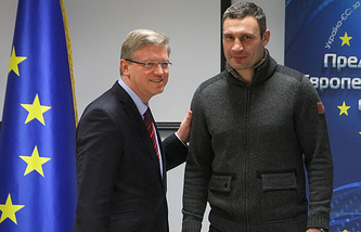 European Commissioner for Enlargement and European Neighborhood Policy Stefan Fule (L) greets Ukrainian opposition leader Vitaliy Klitschko (R) during his visit in Kiev