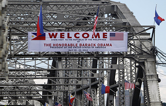 Banners and flags to welcome US President Barack Obama in Manila, Philippines