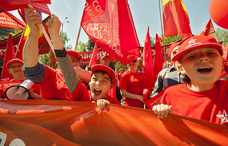 Supporters of the Socialist Party of Moldova attend a rally on the occasion of May Day in downtown Chisinau