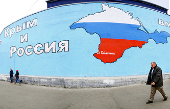 A mural featuring Crimean peninsula painted in the colors of the Russian national flag and reading 'Crimea and Russia' (archive)