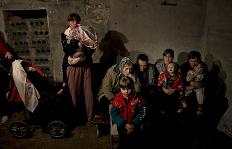 Residents seek refuge in an underground bomb shelter during in Sloviansk